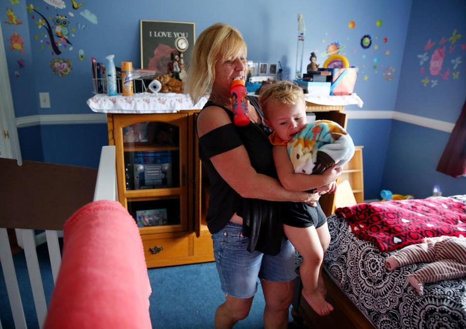 Susan Anderson Lopes prepared her 2-year-old grandson, Mason Anderson, for a nap at their home in Bourne.